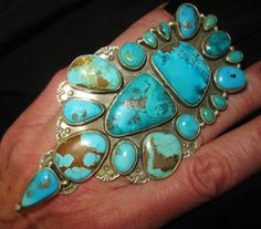 MARY JANE GARCIA made a spectacular ring. Mary Jane Garcia's husband is part of the creation as well. The NAVAJO artist is a perfectionist. SIGNED by the artist MARY JANE GARCIA. It is a striking piece with a sharp style and the most intense blue turquoise!   eBay!