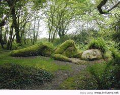 Reclining moss woman. Gaia nurtures us.