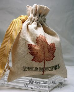 """Magnificent Maple stamps wonderfully on the mini muslim bags, tied beautifully with the Chevron ribbon. Stamp Sets: Thankful, Magnificent Maple Colors: Early Espresso, Cajun Craze, Crushed Curry Embellishments: Crushed Curry 3/4"""" Chevron Ribbon, Mini Muslin Bags"""