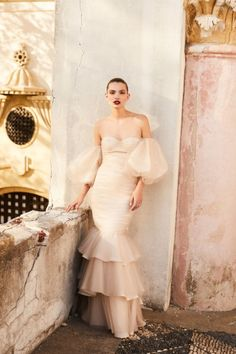 After receiving multiple requests from brides-to-be for custom wedding dresses, Ortiz decided to create a small collection of 12 feminine, unfussy gowns in white, ecru, and blush.