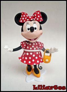 Enfeite+para+bolo+de+aniversário+infantil,+modelado+à+mão+em+biscuit,+baseados+na+personagem+da+Disney,+Minnie+Mouse.+**Também+faço+projetos+personalizados+com+o+tema,+personagens,+cores,+tamanho+e+detalhes+que+você+escolher,+para+mesa+ou+topo+de+bolo.+$$+O+preço+varia+de+acordo+com+o+tamanho+e+detalhes+da+peça.+Criação+e+execução+em+biscuit:+Liliane+Bradbury+de+Oliveira+(ateliê+Liliartes)+Obrigada+pela+visita...+Lili R$ 65,00