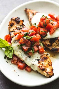 Easy, healthy grilled bruschetta chicken with simple seasonings, melty mozzarella cheese, and a fresh tomato and basil topping is the perfect summer meal! {wine glass writer}