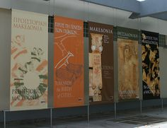 vertical banners inside Thessaloniki Archaeological Museum in Greece. Exhibition Banners, Museum Exhibition Design, Design Museum, Signage Design, Banner Design, Stairs Graphic, Street Banners, Museum Branding, Display Banners