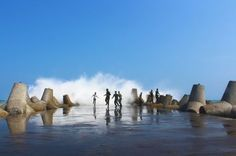 Amazing Indonesia..! Challenging Waves..a group of youths ran when a big waves are of South Java Sea come hit the tetrapod at Glagah Beach, Kulonprogo, Indonesia.