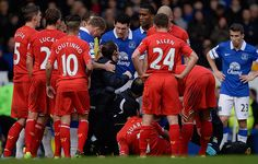 Why does the Liverpool physio get involved with arguing with the referee and Everton players McCarthy and Barry as he treats Suarez?