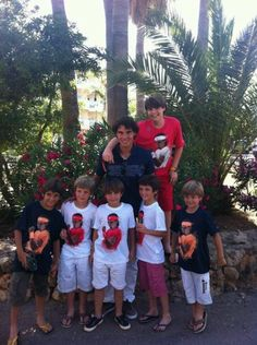A photo that will make hearts melt: Rafa with his little cousins.    [via Amy Miles]