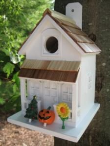 A smaller, yet fully functional version of our Season's Tweetings birdhouse. This cottage style birdhouse comes equipped with three interchangeable, seasonal decorations; a sunflower for Spring and Summer, a Jack-O-Lantern for Fall/Halloween and a Christmas Tree for Winter/Christmas.