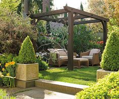 When+you+plan+your+backyard,+remember+that+pergolas+and+arbors+are+often+more+effective+when+used+as+a+stand-alone+architectural+element.+Here,+for+example,+a+pergola+constructed+of+thick+black+timbers+makes+this+small+seating+area+look+like+an+art+installation.+Tight+wire+cables+strung+across+the+top+of+the+pergola+are+strong+enough+to+support+heavy+vines.