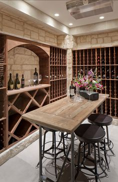 A table and stools turns this wine cellar into a tasting room, too! A table and stools Bar Deco, Wine Cellar Basement, Wine Cellar Racks, Home Wine Cellars, Bar A Vin, Wine Tasting Room, Tasting Table, Wine Cellar Design, Wine House