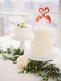 Simple and fun flamingo topped wedding cake: http://www.stylemepretty.com/new-york-weddings/new-york-city/2016/08/19/minimal-and-modern-nyc-wedding/ Photography: Caroline Yoon - http://www.carolineyoonphotography.com/#0