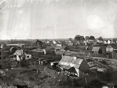 Taken by photographer Timothy OSullivan near the end of the war, this image shows the Hampton freedmens village known as the Grand Contraband Camp. The ruins of St. Johns Church can be seen in the grove of trees near the horizon. American Civil War, American History, Shorpy Historical Photos, History Major, Civil War Photos, Hampton Roads, Vintage Photographs, Vintage Photos, Photo Archive