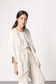 Slouchy white/cream outfit with elasticated trousers and flowing blouse and cardigan. (via elizabeth suzann)