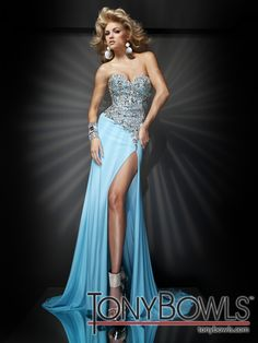 Strapless jersey slim A-line pageant dress with sweetheart neckline, bodice encrusted with metallic stone accents, asymmetrically dropped waistline, high side slit, sweep train. Removable straps included. Sizes: 0 - 20
