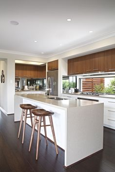 Clarendon Homes. Paddington City 30. Timber stools in this contemporary kitchen adds a sense of timelessness.