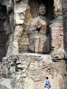 Giant Buddha statue sitting in one of more than 20 caves of Yungang Shiku (Cloud Ridge) in Datong, China.
