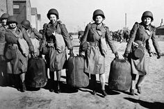 Women help each other with bags at an embarkation port in the U. in this Jan. photo provided by the U. They were bound for North Africa with the first detachment of the Women''s Auxiliary Army Corps to be sent abroad. Today In History, Women In History, History Pics, Modern History, British History, Ancient History, American History, Women In Combat, Cambodian People