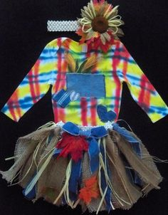 ♥ Artist designed tie dyed girly scarecrow outfit with jute and denim tu tu. Matching headband with sunflower and fall leaves. ♥PERFECT FOR HALLOWEEN♥ So adorable on the little ones with matching corn adorning the pocket. Custom colors can be requested on the shirt. PayPal Only. Starting at $20 and up depending upon size. Affordable shipping with order. Utah. www.facebook.com/...