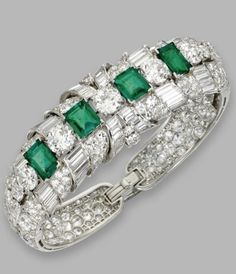 Platinum, emerald and diamond bangle-brancelet, Raymond Yard, circa 1940. Set at the front with emerald-cut emeralds weighing approximately 6.25 carats, accented by old European-cut, single-cut, baguette and tapered baguette diamonds weighing a total of approximately 31.80 carats, internal circumference 6¼ inches, signed Yard by Dreamer412