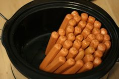 Crock pot hot dogs for entertaining lots of people. No need to add water. Moisture from hotdogs do all the work