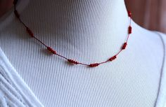 I love this classic, delicate style of necklace. Tiny lipstick red crystals (3mm rondelles) are hand-knotted in groups of four on matching red, pure silk cord.  By J Sadler Designs.