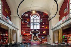 Stedelijk Museum Schiedam: MVRDV wraps interior of historical chapel in red shelves
