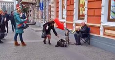 This Street Musician Didn't Expect To See This When He Sat Down For A Performance. So Cool! | The Animal Rescue Site Blog