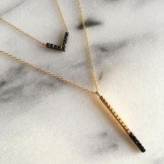 14k gold and oxidized sterling silver bar necklace set with black rose cut diamonds