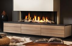 50 Modern Fireplace Ideas – Best Contemporary Fireplaces Edition) - - Looking modern fireplace ideas? Check this collection of best contemporary gas fireplace designs for inspiration - using tiles, marble, brick, glass, metal! 3 Sided Fireplace, Fireplace Tv Wall, Living Room With Fireplace, Fireplace Surrounds, Fireplace Mantels, Home Living Room, Fireplace Ideas, Bioethanol Fireplace, Contemporary Fireplace Designs
