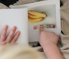 making a toddler words book with photos of child's familiar objects, foods, and people