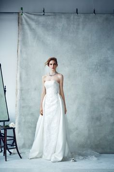 """Oleg Cassini Fall 2015 Collection """"Created with an old world opulencemixed with a modern edge, these gowns offer stunning silhouettes as well as a bit morecoverage done beautifully."""""""