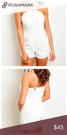 """White Halter Romper Available in sizes Small, Medium or Large.   • Halter Neck • Keyhole Cutout • Polyester/Spandex  Model is wearing a size small. L: 31"""" B: 30"""" W: 28"""" I.S.: 2 1/2""""  *Model shown wearing the exact product.  If you have any questions, feel free to ask! 💕 Pants Jumpsuits & Rompers"""