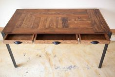 A great desk made out of repurposed wood from a pallet. Has amazing character and patina. Shows the rough life it probably has had, but cleaned up enough to make for a nice little desk. All surfaces sanded and polished nice, but not too much to remove the history of the wood. Legs are an 1 3/4 metal angle iron, adding to the nice heft and feel of this desk.  Dimensions- 30T x 49W x 24D (approx) Side drawer dimensions are approx 15L x 12W x 2D/middle 15L x 18w x 2D  Drawer handles ca...