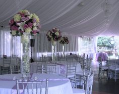 My mom would like this and I kind of like this too. Tall centerpieces  A spot of bling  Light linens