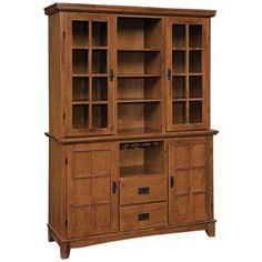 """http://www.fingerhut.com/product//Arts-Crafts-Buffet-Hutch-Oak/K9913.uts?cat=2429    $1,099.99  design in mind. Buffet features 2 cabinets, 2 drawers and removable wine glass rack Hutch features 2 glass-paneled cabinets and open middle section, each with 3 adjustable shelves Buffet 54-1/2""""W x 18""""D x 36""""H Hutch 54-1/2""""W x 18""""D x 40""""H Solid hardwood construction with rich multi-step Cottage Oak finish Assembly required"""