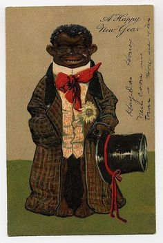 "Antique Americana postcard.  Be sure to read this vertical writing on the right-hand side.  See the words "". .  . New Coon In Town. How Are You. .  ."""