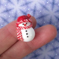 My favorite handmade Christmas beads: my lampwork snowman beads. I put a lot of detail and precise craftsmanship into each of my little glass