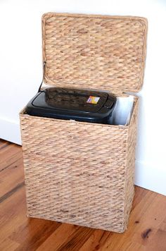 Dog Food Storage - in a trash can, in a woven basket hamper. GENIUS!