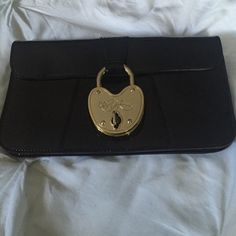 Betsey Johnson Clutch Black patent Betsey Johnson clutch. Good condition. Used maybe a handful of times. Betsey Johnson Bags Clutches & Wristlets