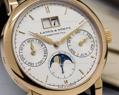 A Lange & Sohne 330.032 Saxonia Annual Calendar, 330032, 18K rose gold with a rose gold tang buckle, silver dial with rose gold hands and numerals, three sub dials indicating day, month and moonphase, big date indicator at 12 o'clock, display back, sapphire crystal, size: 38.5mm, thickness: 9.8mm, Unworn with original box and papers, warranty dated 3/2017.