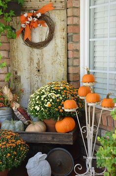 vintage plant stand for pumpkins and a wood trolley as a lardy fall inspired display