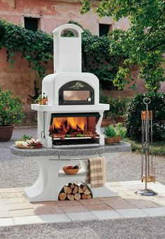 Barbecue design combined with oven - structure made of refractory concrete. Worktop made of marmotech (a special mixture of refractory concrete and marble granulates with high mechanical and high heat resistance) gray polished, granite effect with chromed Pizza Oven Outdoor, Outdoor Cooking, Outdoor Spaces, Outdoor Living, Outdoor Decor, Design Barbecue, Barbecue Garden, Charcoal Bbq, Outdoor Kitchen Design