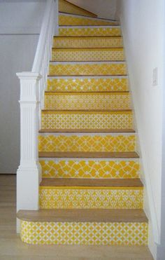 If I'm ever feeling bored and have 100 free hours on my hands, I LOVE this. Our entryway stairs are such a focal point. Something like this would be so cool.