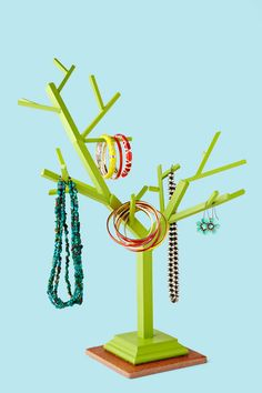 Clean up bedroom clutter in style. Use wood dowels to create a jewelry tree to display and organize accessories.