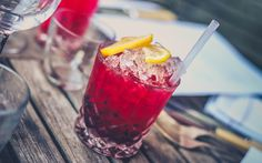 Red Drink on Clear Glass With Lemon on Top  #cocktails #drinks #photography #photos #stockphotos