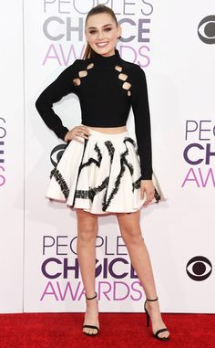 Meg Donnelly from People's Choice Awards 2017 Red Carpet Arrivals  The American Housewife star shows off her fun personality in a black cut-out top and matching skirt.