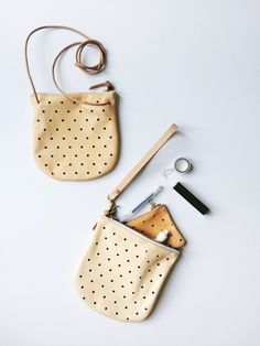 Use this leather crossbody as a clutch by removing the strap and adding a wristlet keychain!