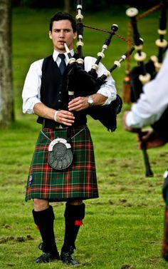 A kilted bagpipe player