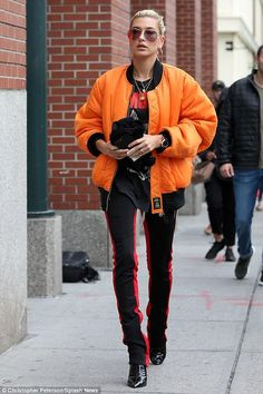 Hailey Baldwin With Kendall Jenner June 2017 Hailey Baldwin wearing Laquan Smith Pvc Booties, Rolex Day-Date Oyster Perpetual Watch, Alpha Industries Blood Chit Flight Jacket, Fear of God Double Striped Track Pants and Prive the Aphrodite Sunglasses Orange Outfits, Orange Mode, Red Bomber Jacket, Bomber Jackets, Hailey Baldwin Style, Orange Jacket, Orange Fashion, Puffy Jacket, Looks Style