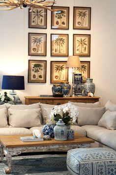 Palm prints hung as a grid.