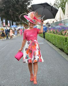 York races: Ladies Day sees glamorous ladies don rain macs   Daily Mail Online